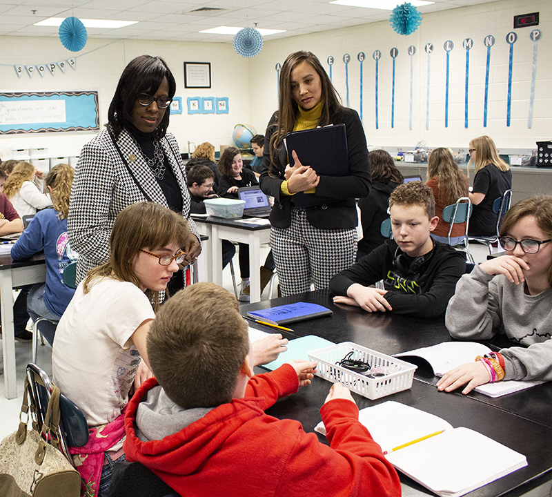 Kentucky lieutenant governor Jenean Hampton and Ashland Community and Technical College Credits Count director Mia Brown talk to seventh grade students at Louisa Middle School.