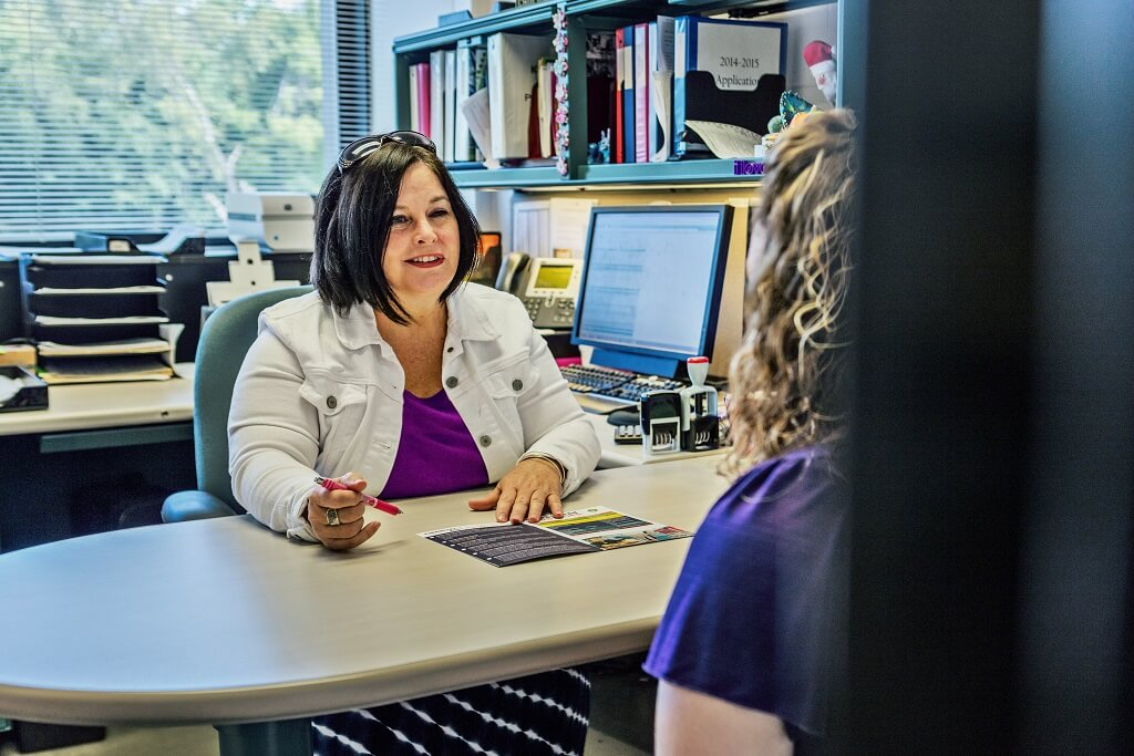 financial aid advisor helping student
