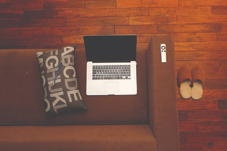 Image of laptop sitting on couch