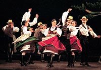 Wearing authentic dress member of the Hungarian State Folk Ensemble performs a traditional dance.